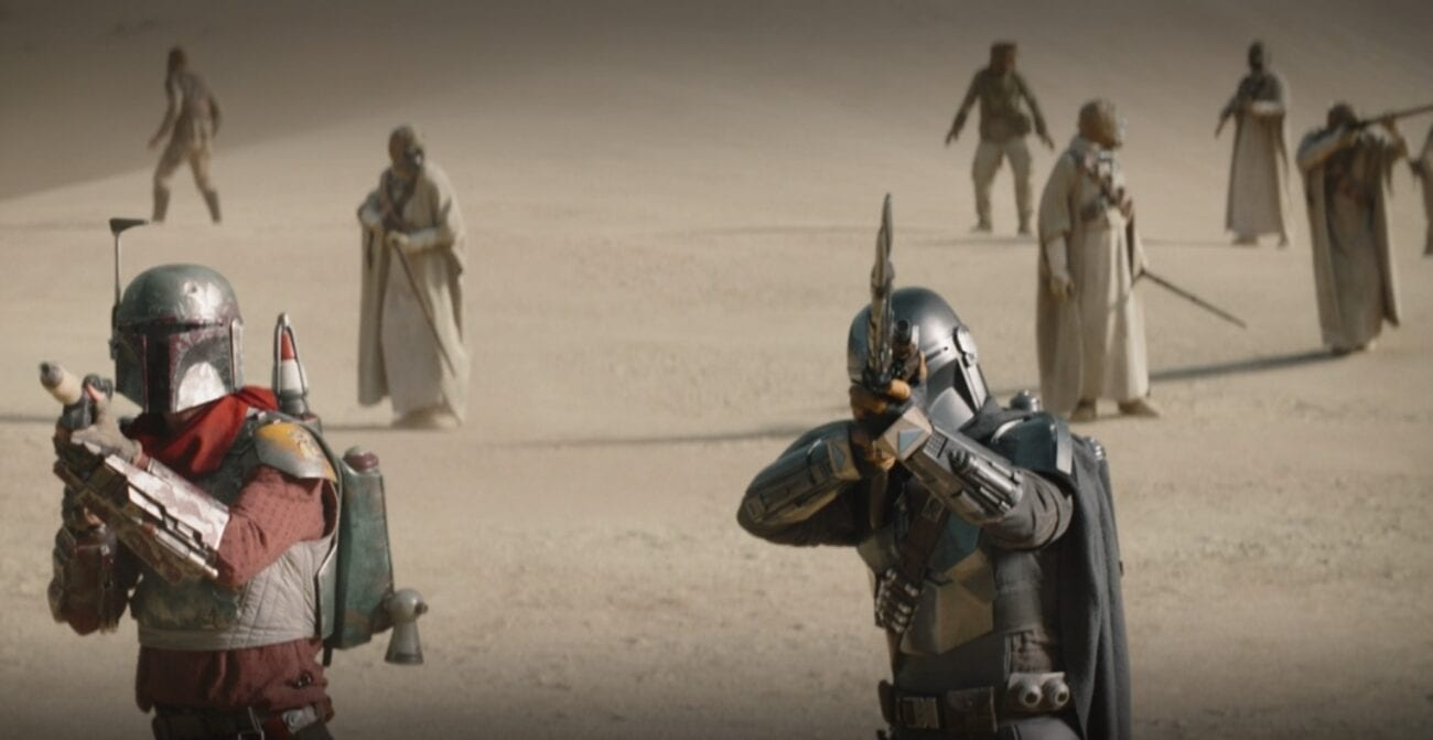 The Mandalorian and Cobb Vanth aim their guns in preparation for an attack