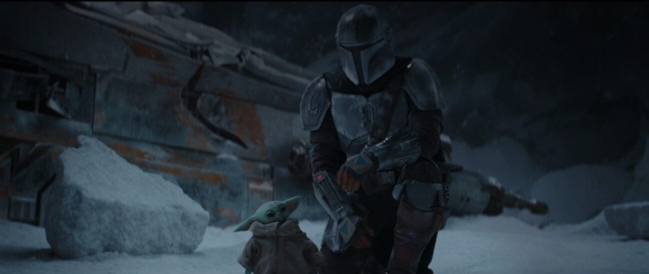 The Mandalorian and The Child in front of what appears to be their ship crashed