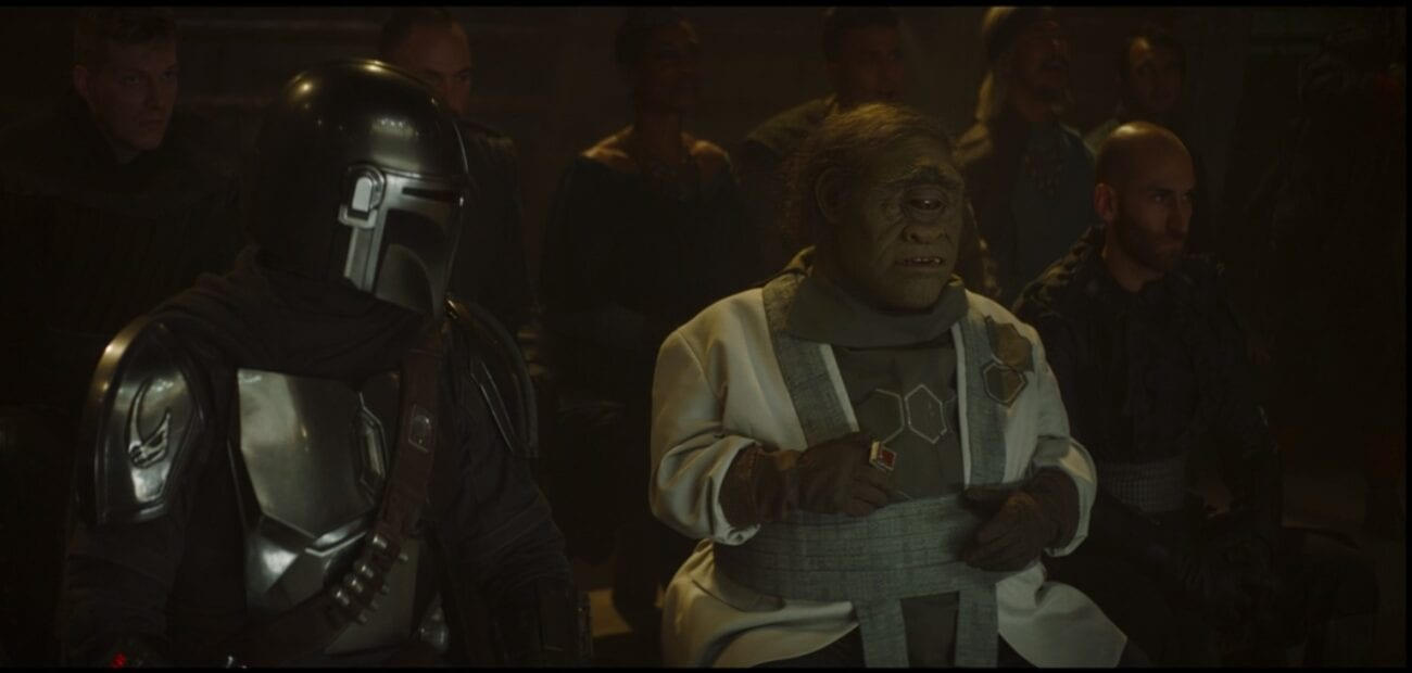 The Mandalorian and Gor Koresh talk from the front row of a fight