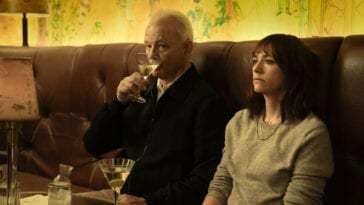 Felix sips a martini next to his gutted and defeated daughter Laura in a bar booth.