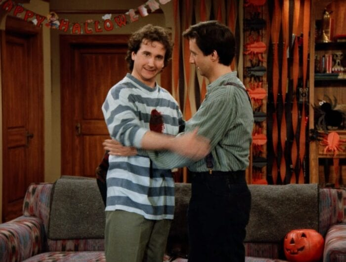 Larry embraces Balki and stares into the camera