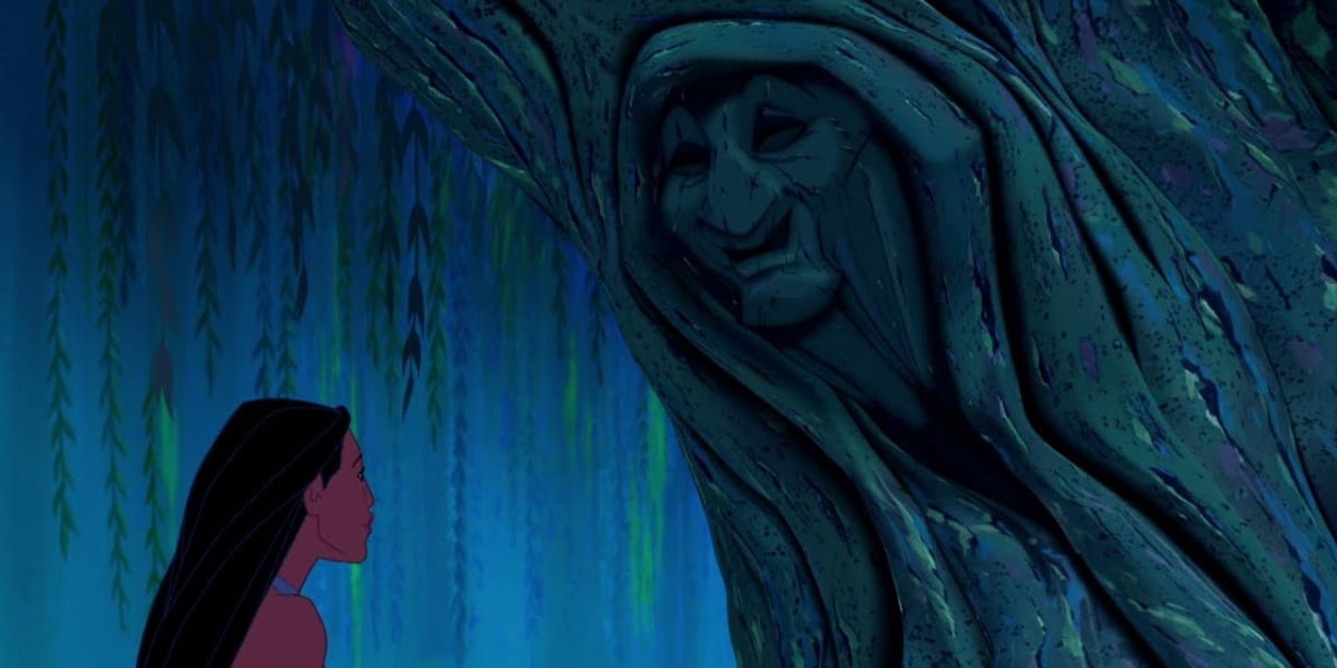Pocahontas speaking with Grandmother Willow, a face carved into a tree
