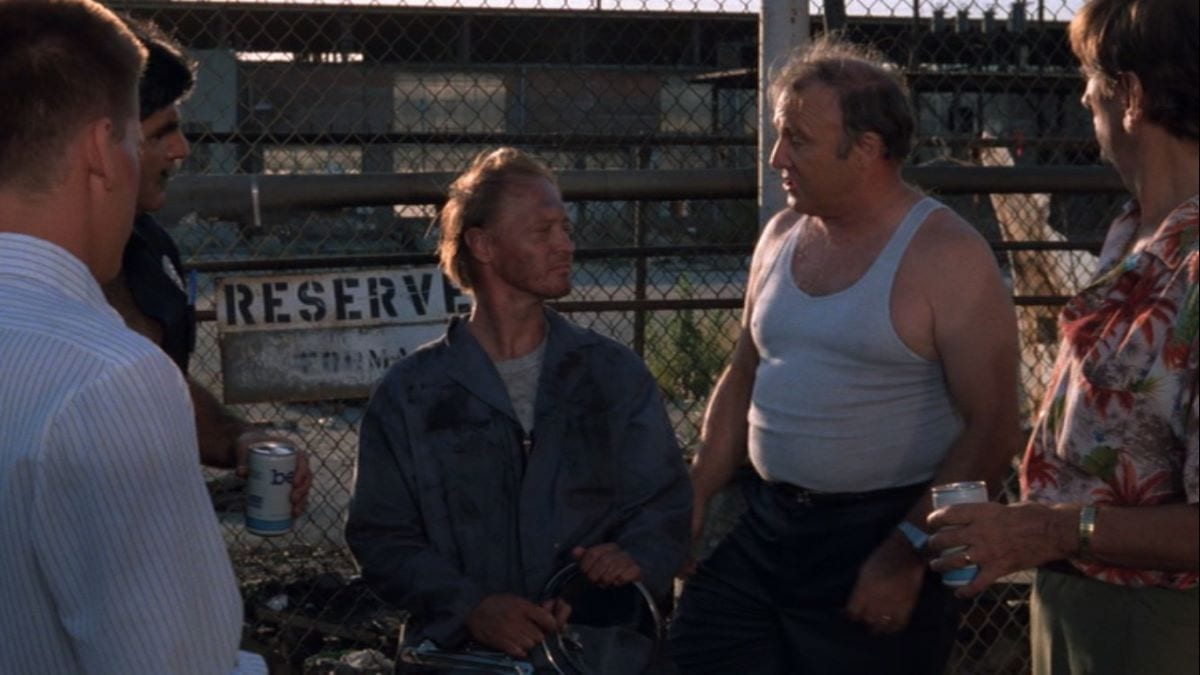 The Repo Men drink beer and discuss philosophy in Repo Man