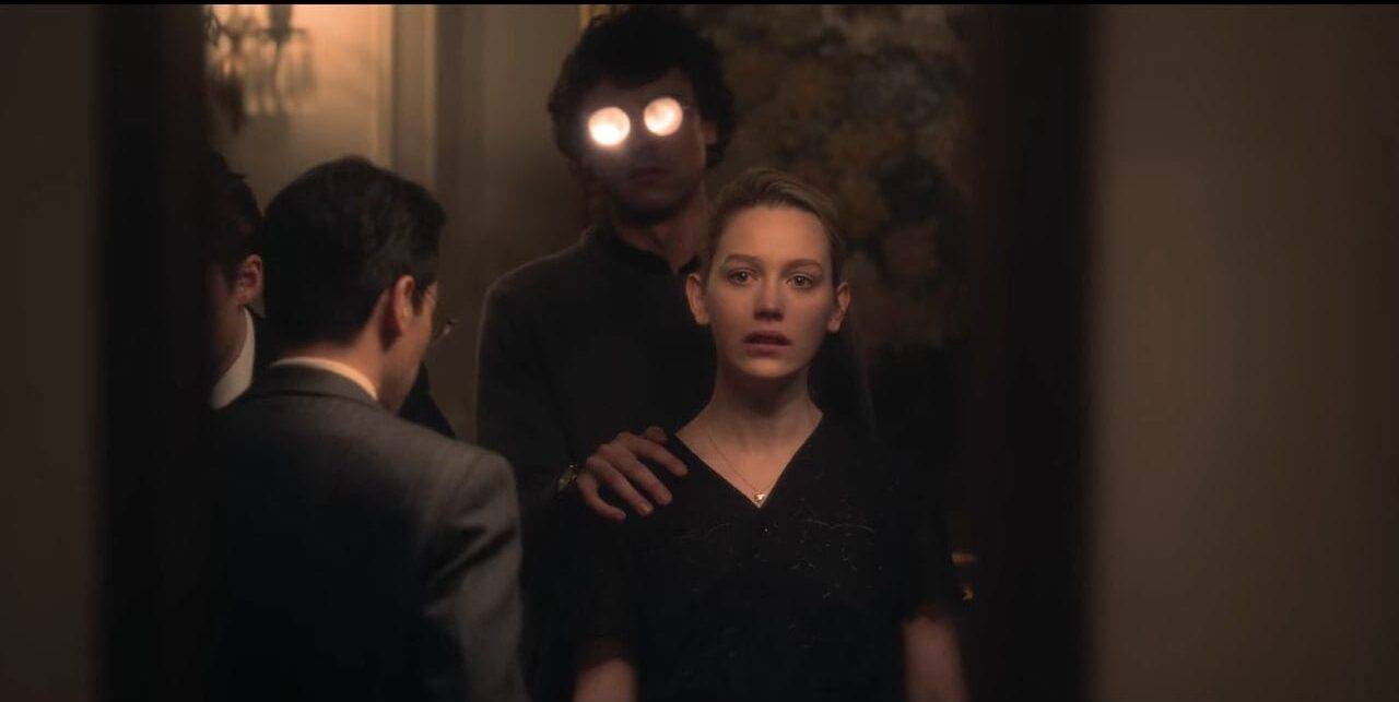 Dani is haunted by Edmund while attending his wake, as he appears behind her with a hand on her shoulder