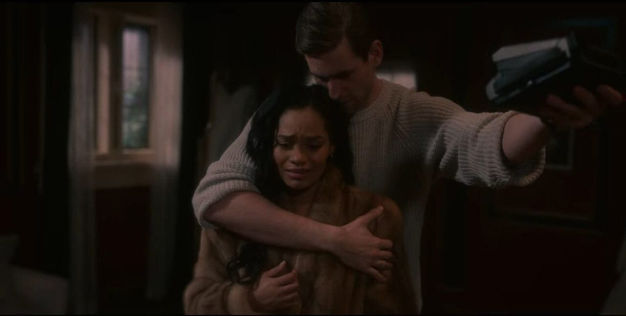Rebecca and Peter embrace, but she is distraught in a scene from The Haunting Of Bly Manor