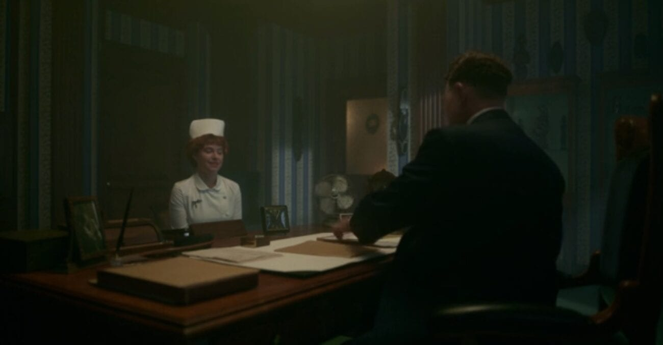Nurse Mayflower is questioned by Doctor Harvard in his office.