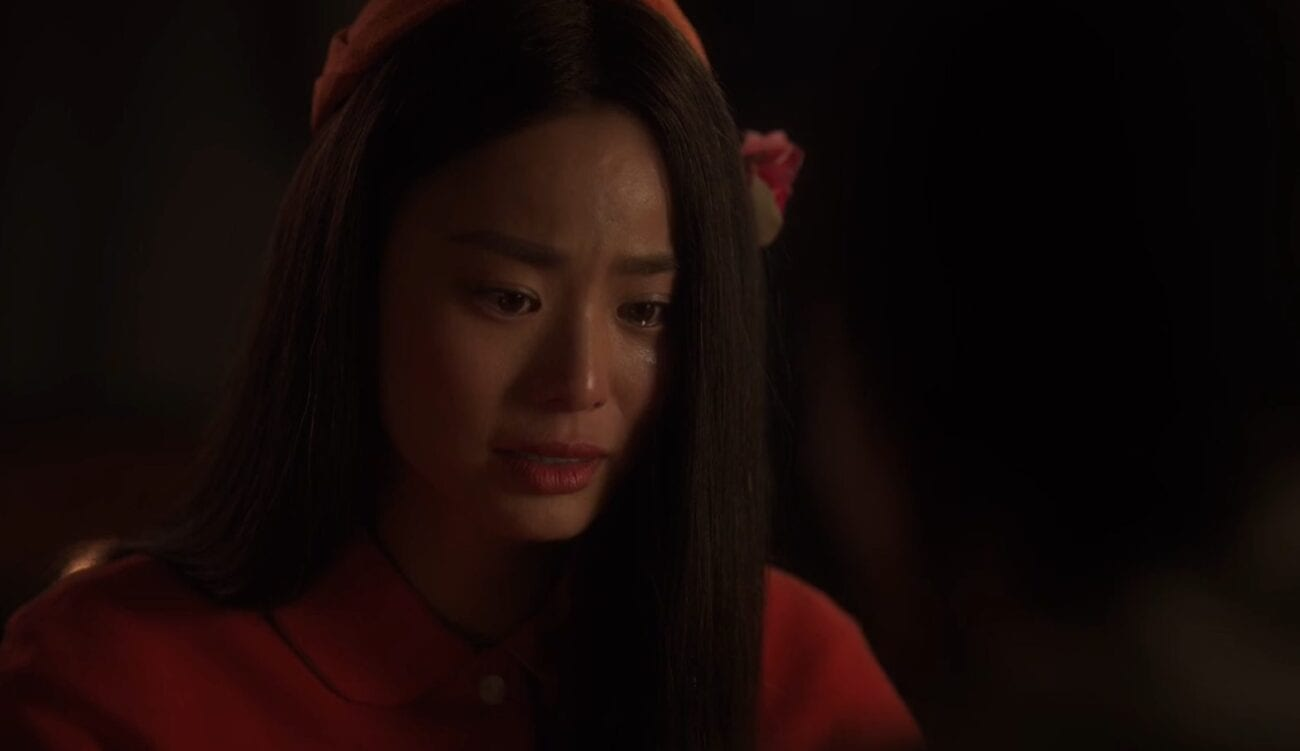 Ji-ah looks on with sadness in her eyes
