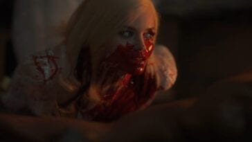 Christina with her face covered in blood