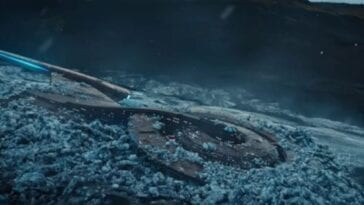 The Starship Discovery covered in ice and stuck in a bed of ice on the surface of a planet in the darkness