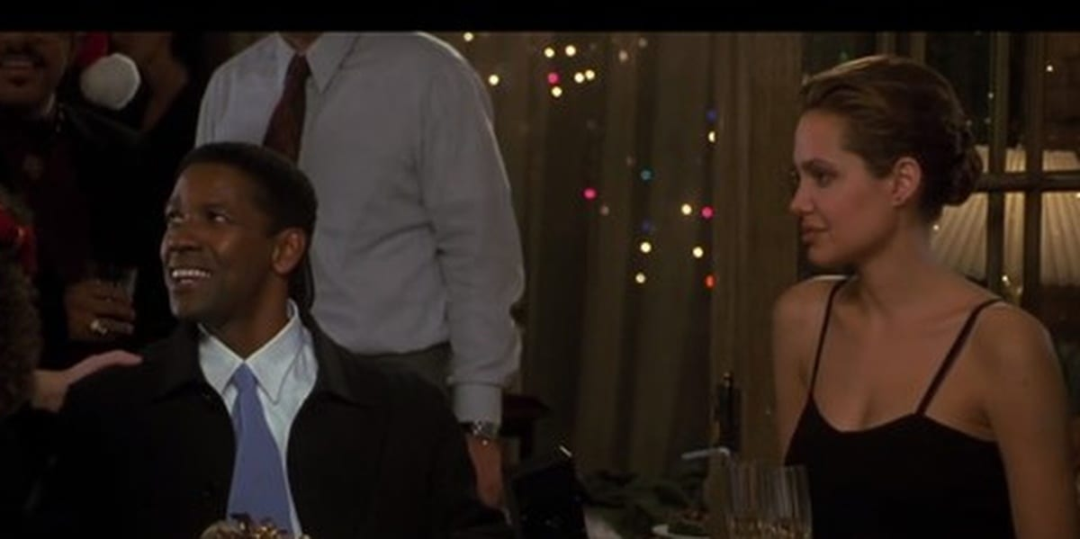Denzel Washington and Angelina Jolie in The Bone Collector at a Christmas party