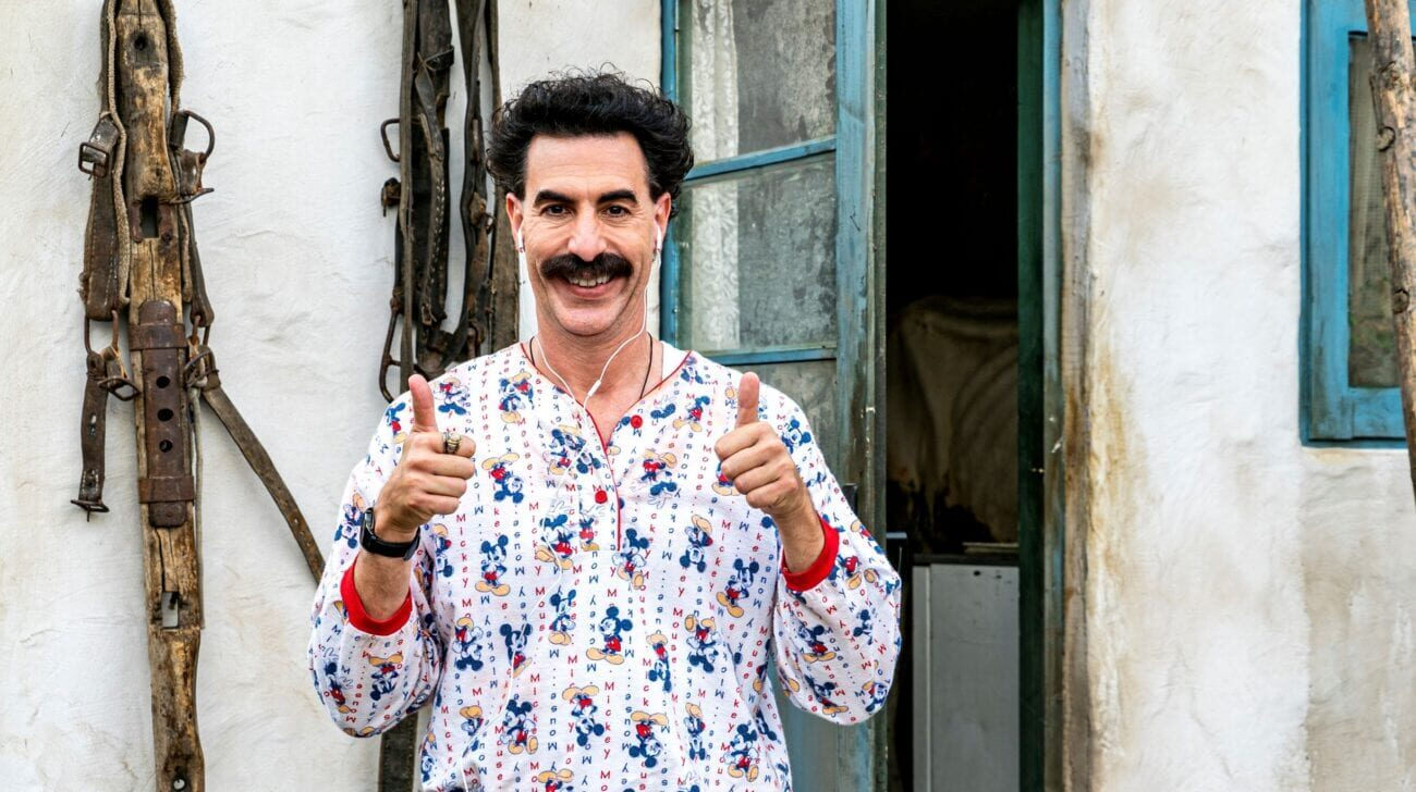 Borat raises two thumbs up while wearing pajamas and an iPod.