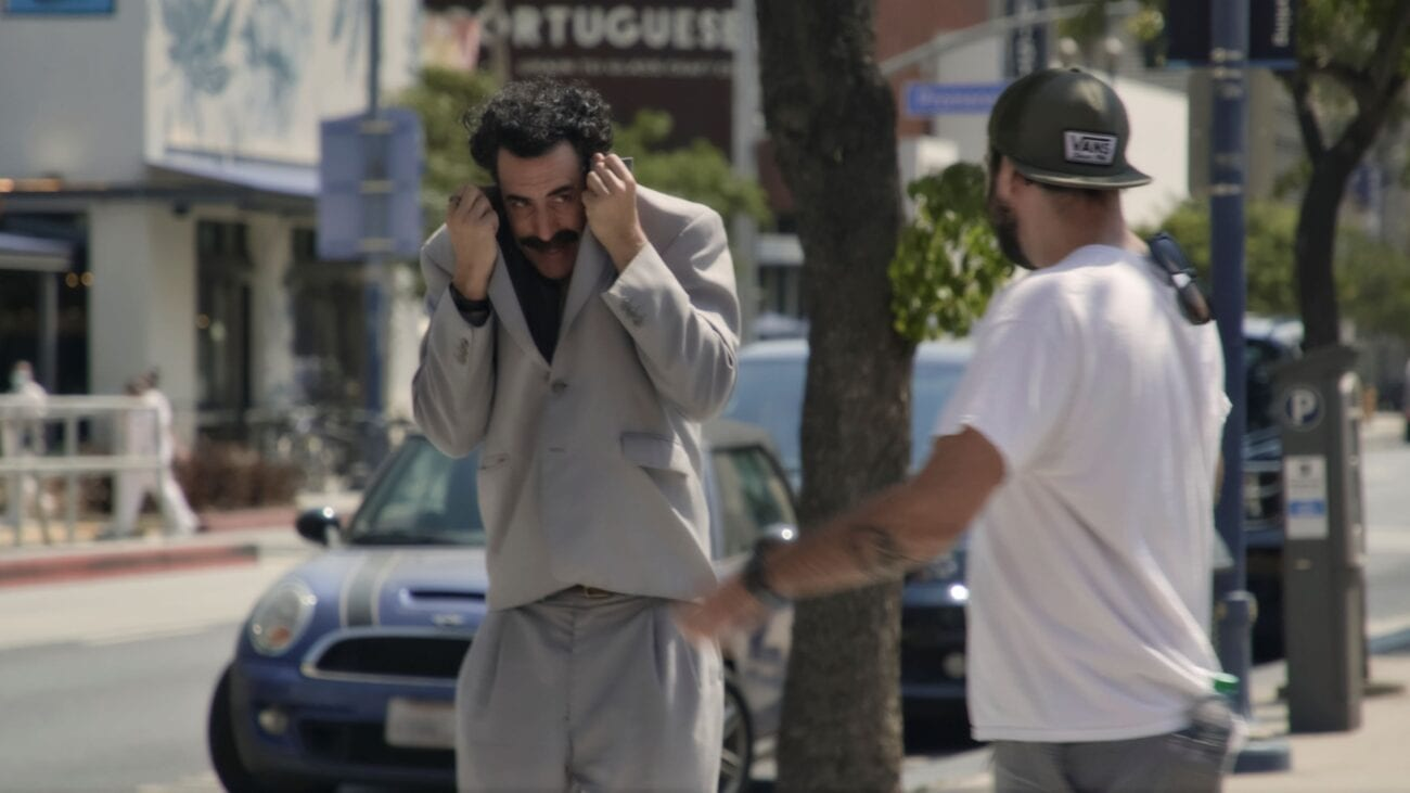 Borat hides in his suitcoat from someone who recognizes him.