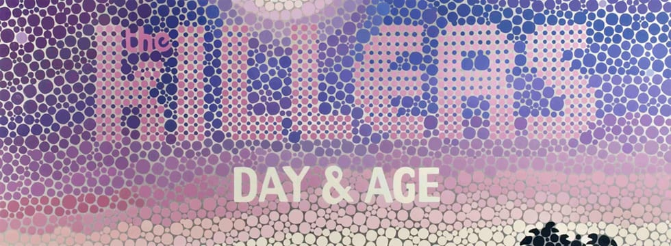 Day and Age album art, purple dots and styalised writing