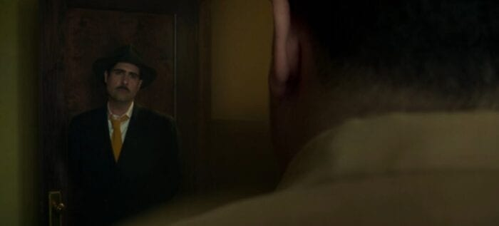 Josto Fadda stares down his brother from the doorway of his office.