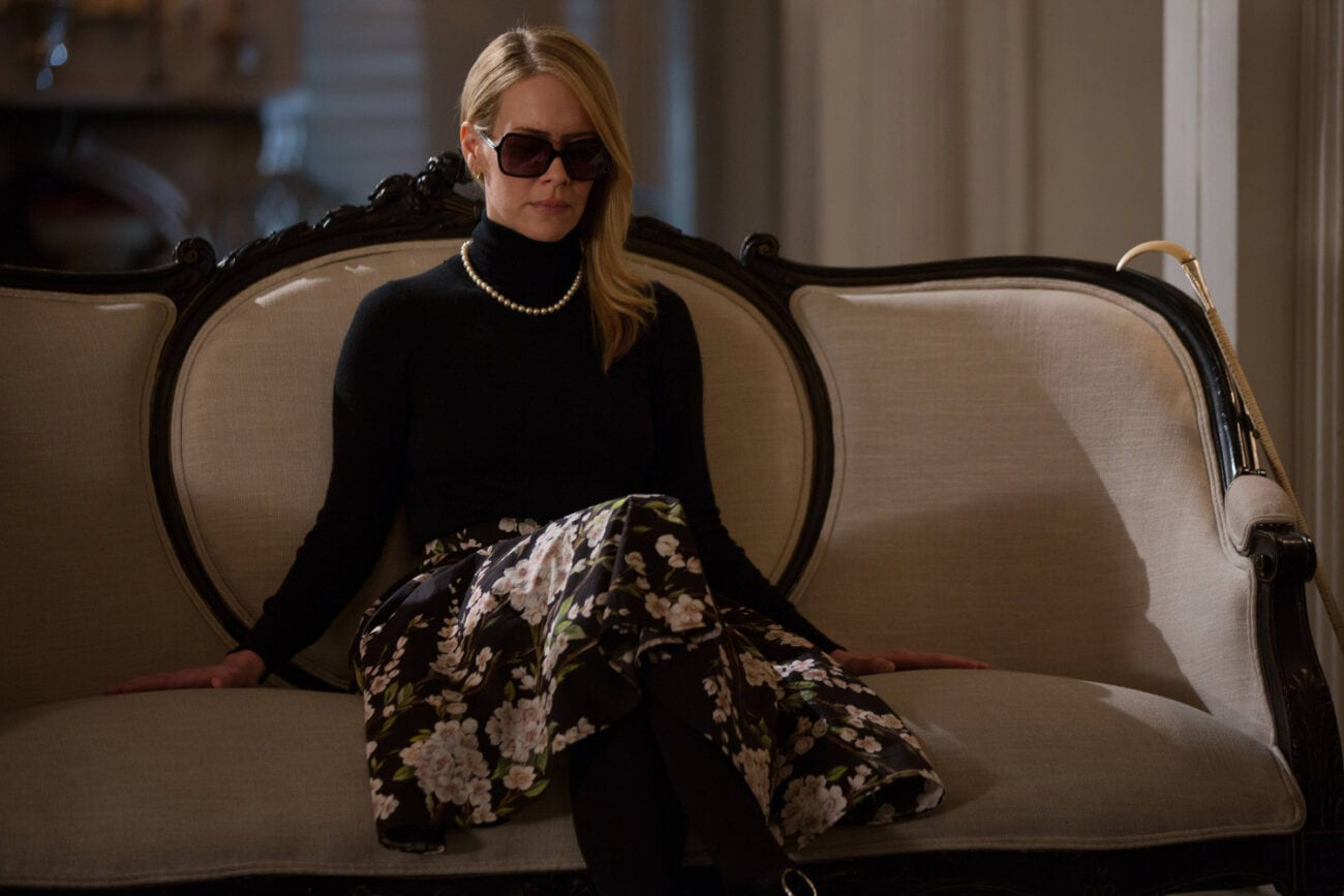A blind Cordelia wearing sunglasses on the couch