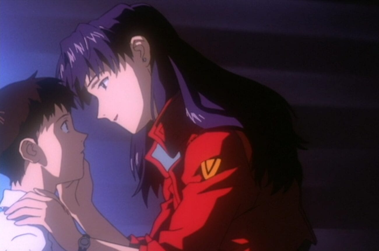 Misato looking into Shinji's eyes and caressing his cheek