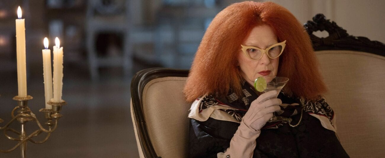 Myrtle Snow drinks a cocktail