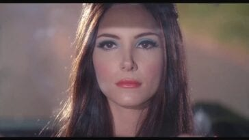 Samantha Robinson looks on in The Love Witch