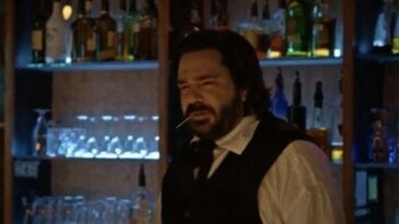 Matt Berry tends bar with a toothpick in his mouth in What We Do In The Shadows