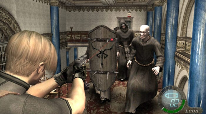 Leon aims his pistol at some cultists in black robes