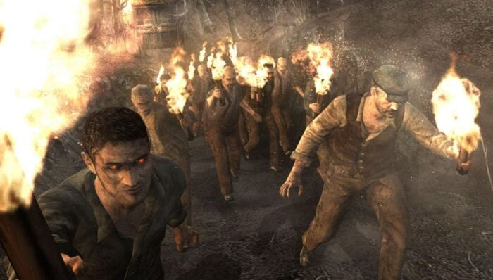 A swarm of villagers wielding torches run towards Leon