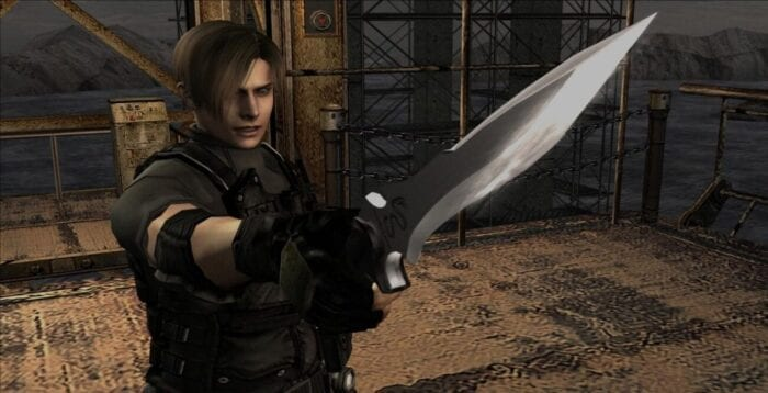 Leon holds up his knife at an enemy off screen.