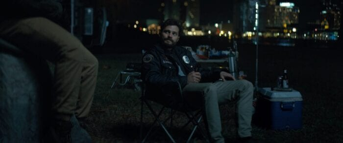 Jamie Dornan in Synchronic. He's talking to Anthony Mackie's character Steve while drinking a beer.
