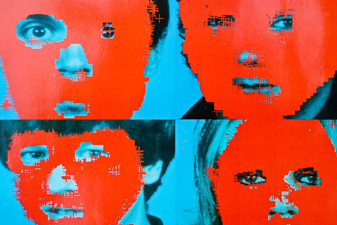 The four members of band Talking Heads in red