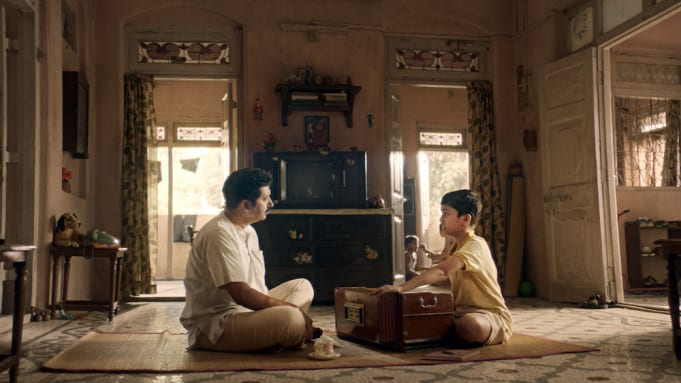 A father teaches his son to sing Alwar in The Disciple