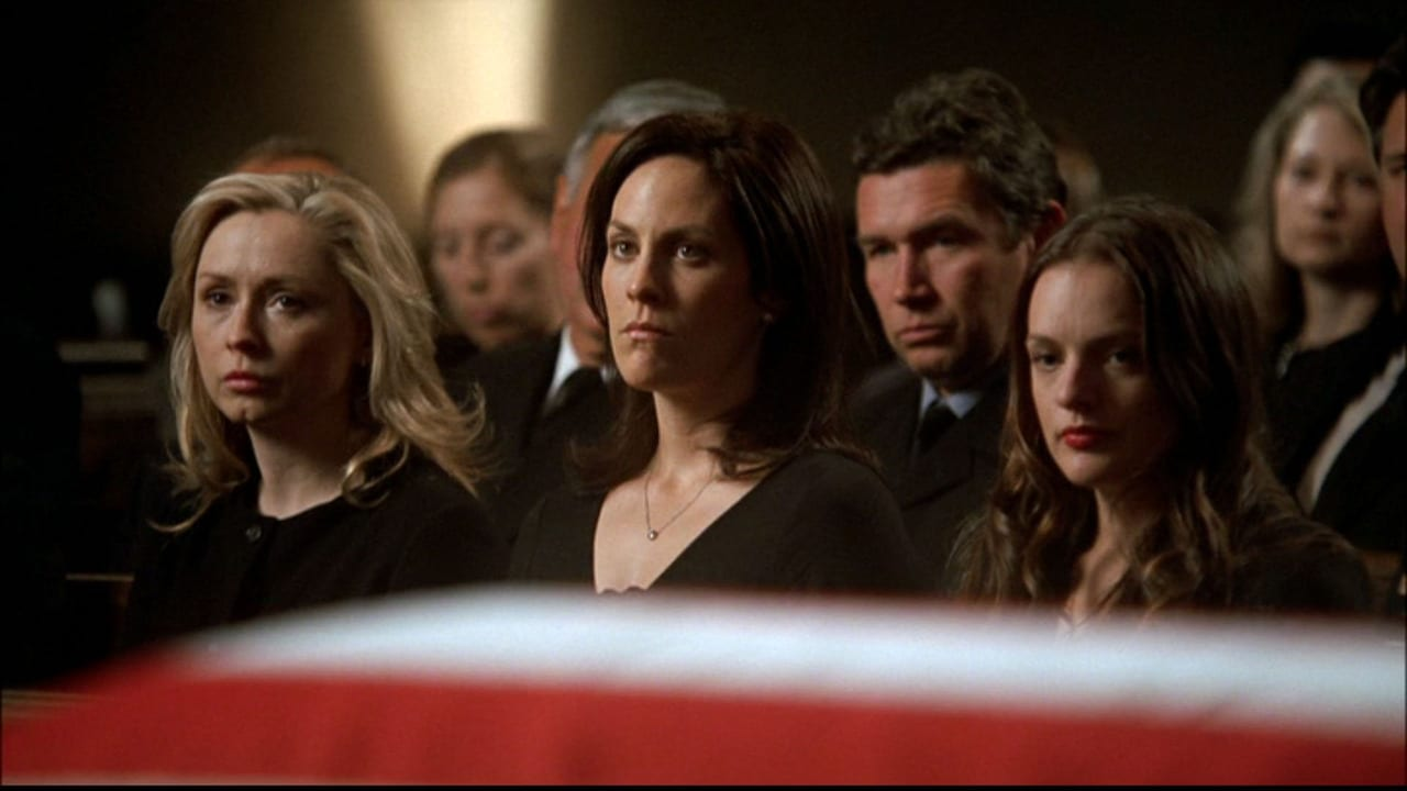 The three Bartlet daughters seated together at the funeral