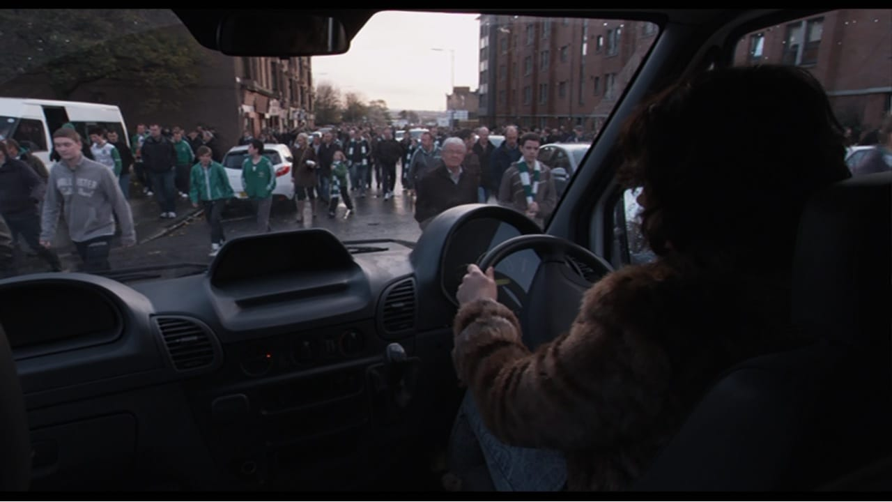 a woman drives a white transit van through crowds of Celtic fans in Glasgow