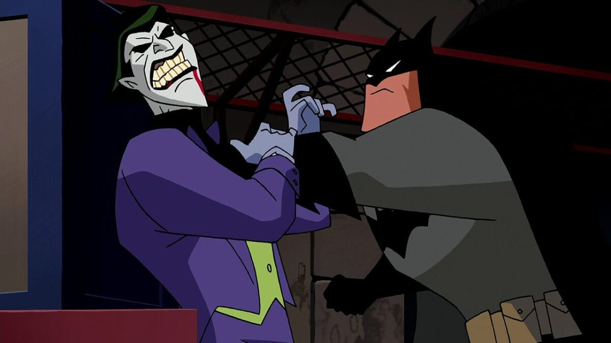 Batman chokes The Joker after he crosses the line