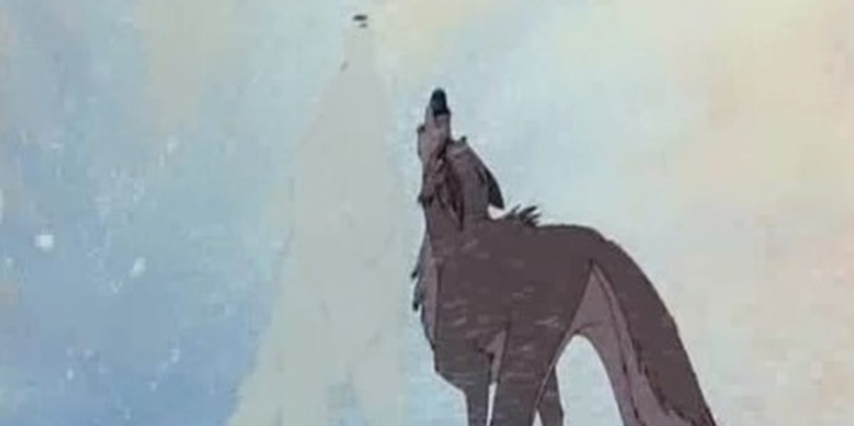 Balto and white wolf howling in a snowstorm