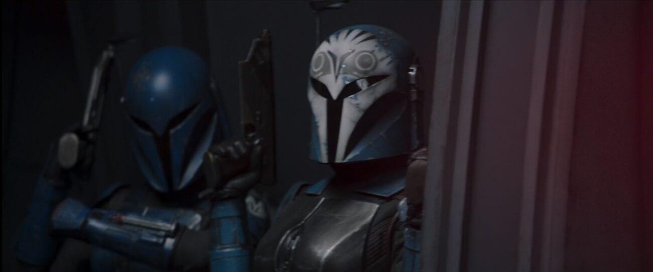 Bo-Katan and Koska, both helmeted, prepare to fight