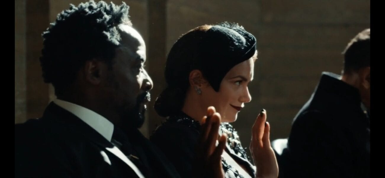 His Dark Materials S2E2 - Lord Boreal and Mrs. Coulter dressed in funeral blacks wave to someone off screen