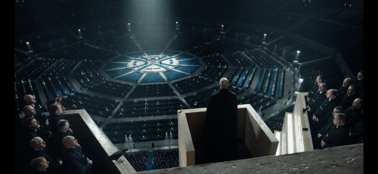 Father MacPhail at a podium addressing Magisterium in a huge auditorium