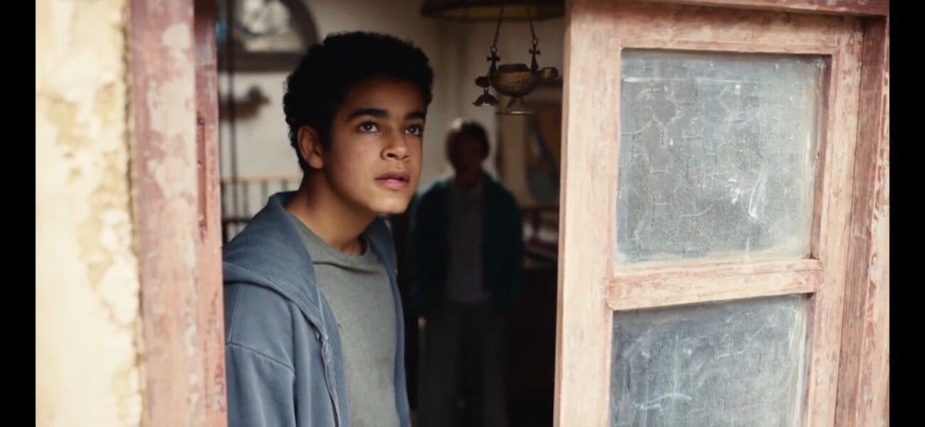 His Dark Materials - Will looks out a window, with Angelica in the shadows behind him