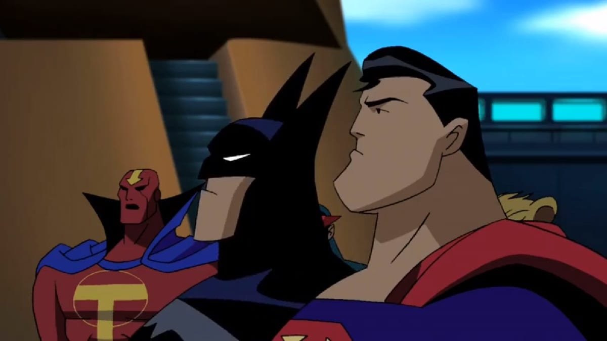 Superman and Batman stand in profile. Red Tornado stands in the background.