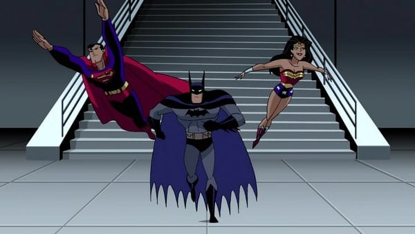 Superman, Batman, and Wonder Woman approach the camera in the final shot of the series. Superman and Wonder Woman are flying, Batman running.