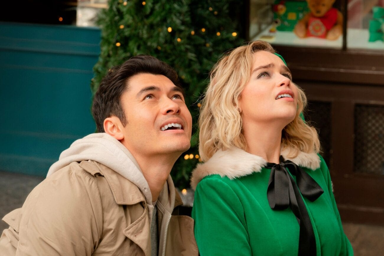 Henry Golding and Emilia Clarke look skyward in Last Christmas