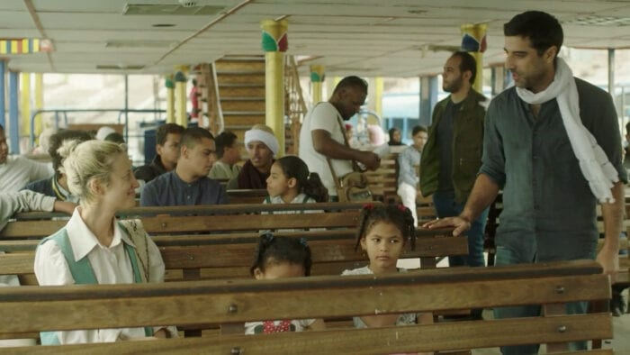 Sultan recognizes Hana sitting on a river ferry.