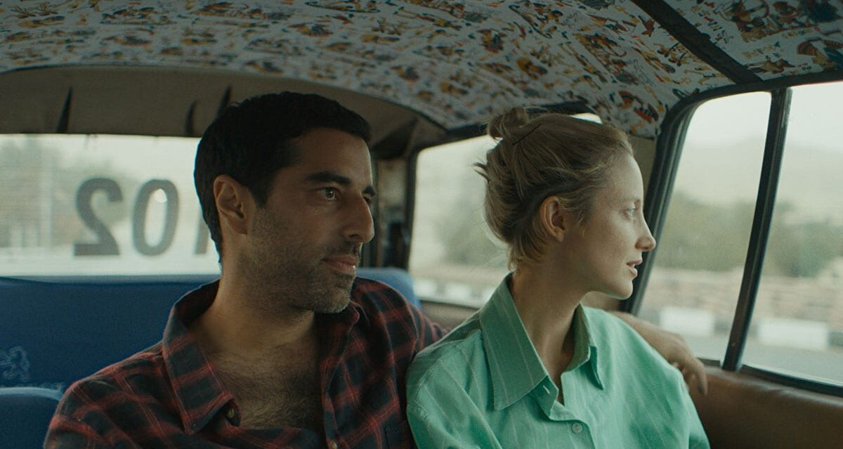Sultan has his arm around Hana as they share a taxi.