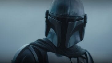 The Mandalorian looks toward the camera