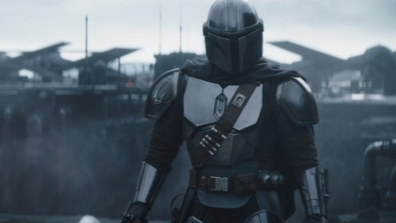 Mando walks on the Imperial base, with TIE fighters in the background