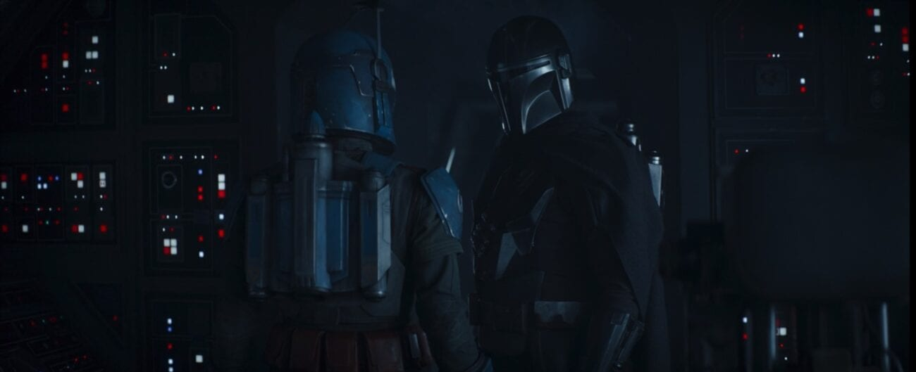 The Mandalorian and Bo-Katan, both helmeted, talk about an Imperial freighter