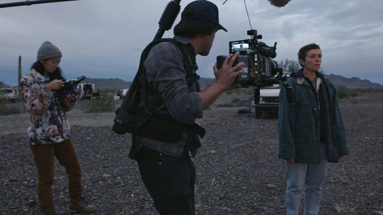 Director Chloe Zhao and cinematographer Joshua James Richards observes Frances McDormand on the set of Nomadland.