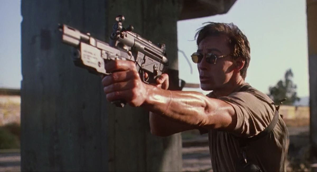 Olivier Gruner holds two guns in the superior straight to video Nemesis from 1993.