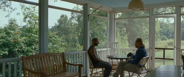 Ruben and Joe sit on a porch to talk.