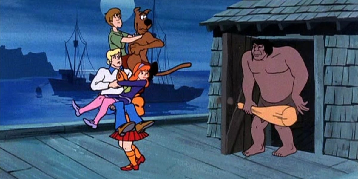 Scooby and the gang being chased by The Caveman in Scooby-Doo Where Are You