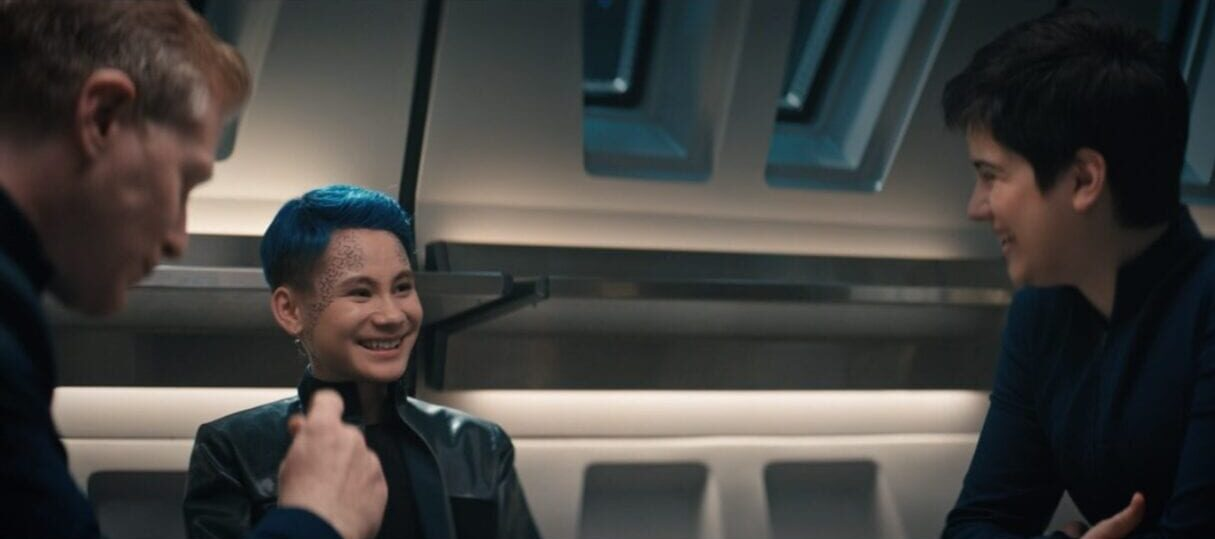 Stamets, Gray, and Adira laugh and look at each other at the mess hall table
